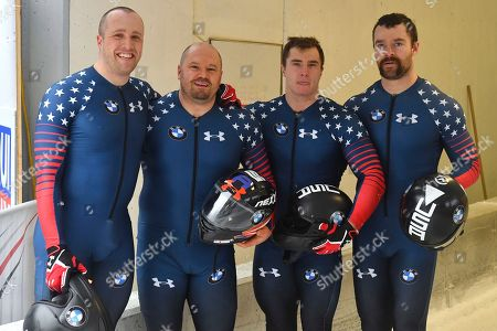 United States' third placed bobsleigh team with Steven Holcomb, second left, and his teammates pose for media after the four-man bob race at the bob World Cup in Igls, near Innsbruck, Austria
