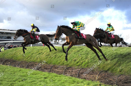 PUNCHESTOWN. AUVERGNAT and Donal McIntyre (right) jumps out over Rubys Double with BALLYBOKER BRIDGE (Davy Rusell) to win for trainer Enda Bolger.
