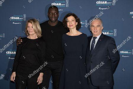Stock Photo of Omar Sy, Nicole Garcia, Minister Audrey Azoulay and President of Academie des Cesars Alain Terzian