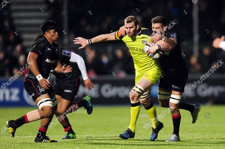 Tom Croft of Leicester Tigers takes on the Saracens defence