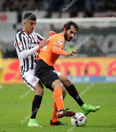 Frankfurt's Aymen Barkok (L) in action against Darmstadt's Hamit Altintop (R) during the German Bundesliga soccer match between Eintracht Frankfurt and SV Darmstadt 98 in Frankfurt, Germany, 05 February 2017.