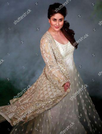 Bollywood actress Kareena Kapoor displays a creation by Anita Dongre at the grand finale during Lakme Fashion Week in Mumbai, India