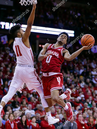Curtis Jones, Jordan Hill Indiana's Curtis Jones (0) shoots against Wisconsin's Jordan Hill (11) during the first half of an NCAA college basketball game, in Madison, Wis