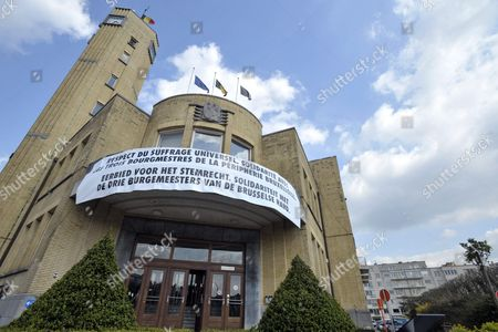 Stock Image of Illustration Picture Shows a Large Banner on the Front of the City Hall of Sint-lambrechts-woluwe - Woluwe-saint-lambert in Brussels Belgium on 09 April 2010 Mayor Olivier Maingain of Fdf Put Up the Banner That Reads 'Respect Du Suffrage Universel Solidarite Avec Les Trois Bourgmestres De La Peripherie Bruxelloise - Eerbied Voor Het Stemrecht Solidariteit Met De Drie Burgemeesters Van De Brussels Rand ' (respect For the Right to Vote Solidarity with the Three Unappointed Mayors of the Brussels Periphery) Belgium Brussels