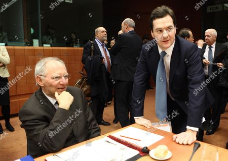 German Finance Minister Wolfgang Schaeuble (l) and Austrian Finance Minister Josef Proell Chat During the Euro Group Finance Ministers Council Meeting at the European Council in Brussels Belgium on 14 February 2011 Concerted Efforts by France and Germany to Impose a 'Competitiveness Pact' on the Eurozone Came Under Fire 14 February and Risked Derailing a Reform of the Currency Bloc Being Discussed by Finance Ministers in Brussels Belgium Brussels