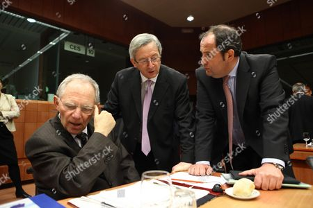German Finance Minister Wolfgang Schaeuble (l) the President of the Eurogroup Luxembourg's Prime Minister Jean-claude Juncker (c) and Austrian Finance Minister Josef Proell (r) Discuss a Point Prior to the Euro Group Finance Ministers Council Meeting at the European Council in Brussels Belgium on 14 February 2011 Concerted Efforts by France and Germany to Impose a 'Competitiveness Pact' on the Eurozone Came Under Fire 14 February and Risked Derailing a Reform of the Currency Bloc Being Discussed by Finance Ministers in Brussels Belgium Brussels
