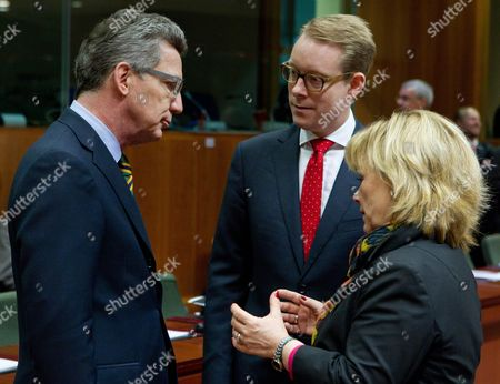 German Interior Minister Thomas De Maiziere (l) Speaks with Swedish Minister of Migration and Asylum Policy Tobias Billstrom (c) and Swedish Minister of Justice Beatrice Ask (r) Pictured Ahead of a European Justice and Home Affairs Council Meeting Thursday 24 February 2011 in Brussels Belgium Brussels
