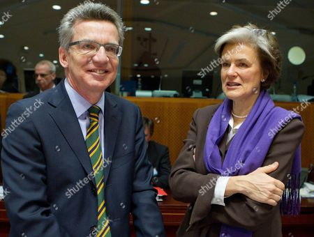 German Interior Minister Thomas De Maiziere (l) and Finnish Minister of Migration and European Affairs Astrid Thors (r) Pictured Ahead of a European Justice and Home Affairs Council Meeting Thursday 24 February 2011 in Brussels Belgium Brussels