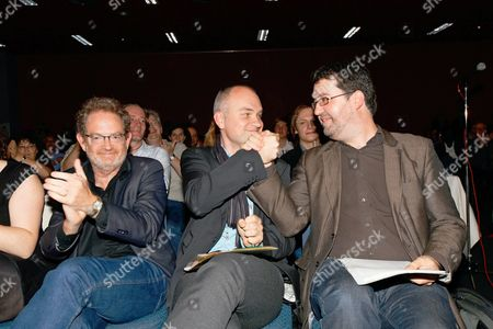 Stock Image of Wouter Van Besien (r) and Bjorn Rzoska (c) Celebrate As They Are Re-elected As Respectively Groen! Chairman and Groen! Vice-chairman Alongside Green Politician Luckas Vander Taelen (l) at a Party Conference at the Icc in Gent Belgium on 09 October 2010 Belgium Gent