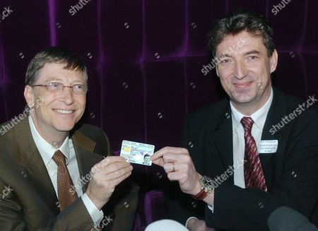 Microsoft Founder Bill Gates (l) Poses For a Picture with Belgian State Secretary For Computerisation of the State Peter Vanvelthoven (r) and a Belgian Electronic Identity Card Tuesday 01 February 2005 in Brussels Bill Gates Announced They Will Adapt Msn Messenger to Electronic Id For More Security For Childs on Internet Belgium Brussels