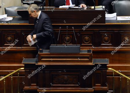 Outgoing Belgian Prime Minister Yves Leterme Leaves the Speakers' Rostrum During a Plenary Session of the Chamber at the Federal Parliament in Brussels 01 December 2011 Belgian Political Parties Agreed Late 30 November to a Governing Coalition Led by Social Democrat Elio Di Rupo From the French-speaking Southern Region of Wallonia the News Agency Belga Reported the Country Has Been Without a Government For 535 Days As Coalition Talks Repeatedly Failed Since June 2010 Parliamentary Elections the Agreement Eases Fears That Belgium a Country of 10 Million in the Heart of Europe Could Break Apart Belgium Brussels