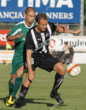 (l-r) Cercle's Denis Viane and Tps Turku's Jonatan Johansson Fight For the Ball During the Second Qualification Game of the Europa League Between Cercle Brugge and Tps Turku of Finland in the Jules Ottenstadion in Gentbrugge Belgium Thursday 15 July 2010 Belgium Gentbrugge