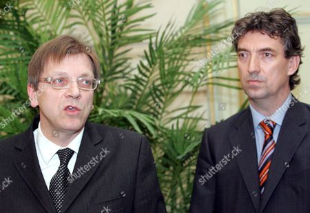 Stock Image of Belgian Prime Minister Guy Verhofstadt (l) and Federal Employment Minister Peter Vanvelthoven (r) Give a Press Conference on the Decision of Volkswagen to Fire Around 3500 Workers of the Factory in Vorst / Forest Near Brussels Tuesday 21 November 2006 Vw Will Only Keep 1500 People Working in Their Belgian Plant Belgium Brussels