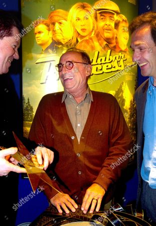 French Actor Claude Brasseur (c) and Film-maker Gilles Legrand (r) Receive a Star Offered by Kinepolis Group During the Presentation of His New Film 'Malabar Princess' Monday 22 March 2004 in Brussels Belgium Brussels