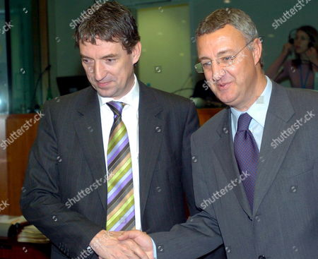 Stock Picture of Belgian Employment Minister Peter Vanvelthoven (l) Talks to His Spanish Counterpart Jesus Caldera (r) at the Beginning of the Eu Employment and Social Policy Council Thursday 08 December 2005 at the Eu Headquarters in Brussels Belgium Brussels