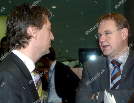 Belgian Employment Minister Peter Vanvelthoven (l) Talks to His Dutch Counterpart Aart-ian De Geus (r) at the Beginning of the Eu Employment and Social Policy Council Thursday 08 December 2005 at the Eu Headquarters in Brussels Belgium Brussels