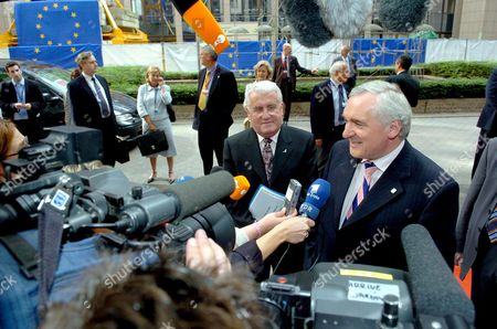 Irish Prime Minister Bertie Ahern (r) and European Affairs Minister Dick Roche (c) Whose Country Currently Holds the Rotating Presidency of the Eu Arrives For an Extraordinary European Summit Tuesday 29 June 2004 at the Eu Council Headquarters in Brussels Belgium Brussels