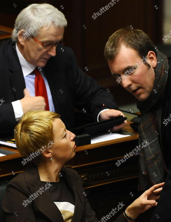 Stock Photo of Catherine Fonck of Cdh (l) State Secretary For Budget and Asylum Policy and Migration Melchior Wathelet of the French-speaking Christian Democrats (r) and Christophe Bastin (cdh) (c) Pictured During a Plenary Session of the Chamber at the Federal Parliament in Brussels Belgium 17 November 2011 Belgium Brussels