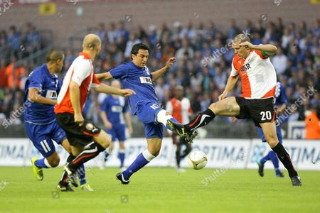 Gent's Randall Azofeifa (c) and Feyenoord's Ron Vlaar (r) Fight For the Ball During the Uefa Europa League Play Off 2nd Leg Match Between Belgian Kaa Gent and Dutch Fc Feyenoord in Gent 26 August 2010 Belgium Gent