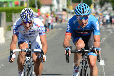 French Rider Pierrick Fedrigo (l) of the Fdj-bigmat Team is on His Way to Win the 15th Stage of the Tour De France Cycling Race Over 160km From Samatan to Pau France 16 July 2012 at Right Second Placed Us Rider Christian Vande Velde of the Garmin-sharp-barracuda Team France Pau