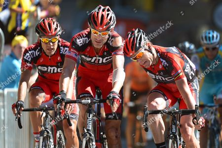 (l-r) French Rider Amael Moinard Us Rider George Hincapie and Australia's Cadel Evans All of the Bmc Racing Team Cross the Finish Line During the 16th Stage of the Tour De France Cycling Race Over 197km From Pau to Bagneres-de-luchon France 18 July 2012 France Bagneres-de-luchon