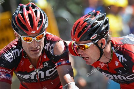 Us Rider George Hincapie (l) and Australia's Cadel Evans (r) Both of the Bmc Racing Team Cross the Finish Line During the 16th Stage of the Tour De France Cycling Race Over 197km From Pau to Bagneres-de-luchon France 18 July 2012 France Bagneres-de-luchon