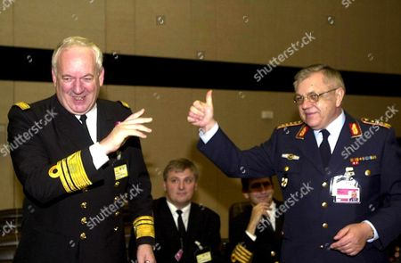 Brussels Belgium: Newly Elected Chairman of the Military Committee German General Harald Kujat (r) Greets Belgian Chief of Staff Vice-admiral Willy Herteleer (l) who was Also Candidate After the Cast That Took Place During the 144 Th Meeting of the Military Committee in Chiefs of Staff Session Tuesday 20 November 2001 at the Nato Headquarters in Brussels