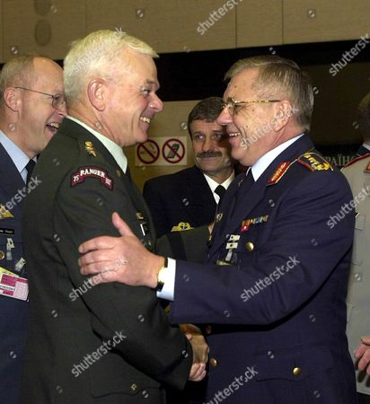 Brussels Belgium : German General Harald Kujat (r) is Being Welcomed by Saclant General William Kernan (l) at the Beginning of the 144th Meeting of the Military Committee in Chiefs of Staff Session on Tuesday 20 November 2001 at the Nato Headquarters in Brussels