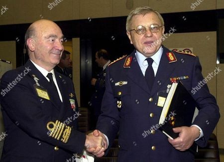 Brussels Belgium: Newly Elected Chairman of the Military Committee German General Harald Kujat (r) Shakes Hand with Outgoing Italian Admiral Guido Venturoni (l) After the Cast That Took Place During the 144 Th Meeting of the Military Committee in Chiefs of Staff Session Tuesday 20 November 2001 at the Nato Headquarters in Brussels