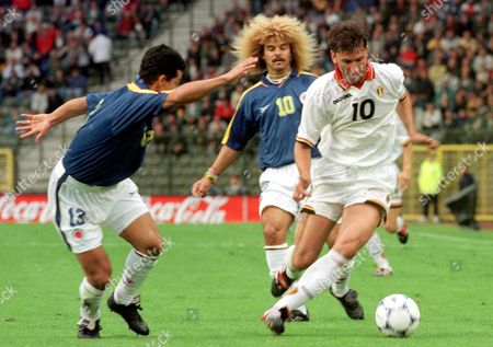 Bru31-19980603-brussels Belgium: Belgian Player Luc Nilis (r) Plays the Ball Before Colombian Defender Wilmer Cabrera (l) and Columbian Carlos Valderama (c) This 03 June 1998 Evening in the King Baudouin Stadium in Brussels During Their Friendly Match in Preparation of the World Cup Epa Photo Belga/david Pierson/dap/kr Belgium Brussels