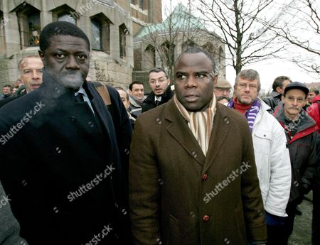 Olympic Marseille General Manager Pape Diouf (l) and Foremer Player Basile Boli (r) Leave the Basilique of Koekelberg in Brussels After the Funeral Service of Late Soccer Coach Raymond Goethals Monday 13 December 2004 European Cup Winning Manager Raymond Goethals Died 06 December 2004 Aged 83 After a Long Illness Belgium Brussels
