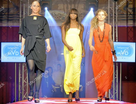 (l-r) Slovenian Triple Jump Athlete Snezana Rodic Belgian Athlete Elodie Ouedraogo and Belgian Athlete Olivia Borlee Wearing Dresses in the Colour of the Belgian Flag During the Memorial Van Damme Gala Evening Ahead of the Memorial Ivo Van Damme - Diamond League Meeting in Brussels Belgium on 25 August 2010 the 2010 Memorial Van Damme Takes Place on 27 August 2010 Belgium Brussels