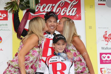 Stock Image of Australian Robbie Mcewen of Team Radioshack and His Son Ewan Celebrate on the Podium After Robbie Mcewen Won the Fourth Stage of the Tour De Wallonie From Enghien to Mouscron (151 6 Km) 26 July 2011 in Mouscron Belgium Belgium Mouscron