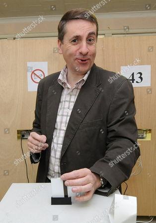 Stock Picture of Fdf Chairman Olivier Maingain Casts His Vote at the Polling Station During the Federal Election Day Brussels Belgium 13 June 2010 Polls Opened Across Belgium For a Snap Election a Year Ahead of Schedule Following the Collapse of the Government in a Power Struggle Between Dutch- and French-speaking Parties Belgium Brussels
