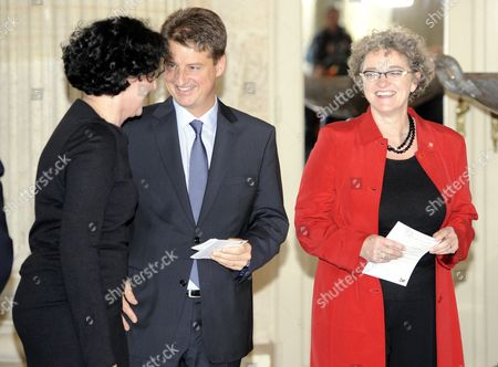 (l-r) Minister of Justice Annemie Turtelboom (open Vld Flemish Liberals) Budget Minister and Minister of Administrative Simplification Olivier Chastel (mr French-speaking Liberals) and Minister of Employment Monica De Coninck (sp a Flemish Socialists) Pictured During the Oath Ceremony in Front of King Albert Ii (not Pictured) at Laeken/laken Castle in Brussels Belgium 06 December 2011 Belgium's Record-length Political Crisis Reached a Formal End on 05 December As French-speaking Socialist Leader Elio Di Rupo was Appointed Prime Minister by King Albert Ii the 60-year-old Di Rupo the Son of Poor Italian Migrants is Set to Become Europe's First Openly Gay Male Leader Barring Another Political Crisis His Government Will Govern Until the End of the Current Parliamentary Term in 2014 Belgium Brussels