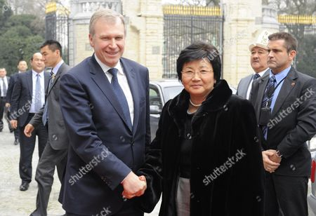 Stock Image of Outgoing Belgian Prime Minister Yves Leterme (l) Welcomes President of Kyrgyzstan Roza Isakovna Otunbayeva For a Meeting in Brussels Belgium on 01 March 2011 Belgium Brussels