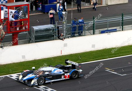 Peugeot Team Car 7 with Drivers Nicolas Minassian Christian Klein and Simon Pagenaud Crosses the Finish Line and Wins the 1000 Km of Spa at the Francorchamps Racing Circuit in Spa 10 May 2009 the 1000 Km Race in Spa is a Part of the Le Mans Series 2009 Belgium Spa
