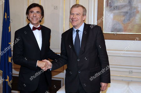 Outgoing Prime Minister Yves Leterme (r) Hands Over the Keys of His Office to Newly Appointed Prime Minister Elio Di Rupo (l) at the Wetstraat 16 - Rue De La Loi 16 in Brussels 06 December 2011 540 Days After the General Elections of 13 June 2010 the Longest Political Crisis Belgium Eventually Has a Government with For the First Time Since 1974 Led by French-speaking Socialist Leader Elio Di Rupo Di Rupos Six-party Coalition Government Has 12 Other Cabinet Members Equally Split Between the Francophone Walloons and Dutch-speaking Flemish Political Forces Which Represent the Country's Two Increasingly Split Communities Belgium Brussels