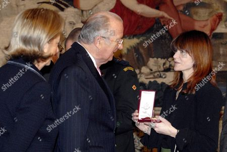 Belgian Queen Paola and King Albert Ii Meet with Belgian Singer Axelle Red (fabienne Demal) During a Reception at the Royal Castle For People who Received a Nobility Title in 2007 in Laeken-laken Brussels Belgium 20 December 2007 Axelle Red Received the Title of Commander in the Crown Order Belgium Brussels