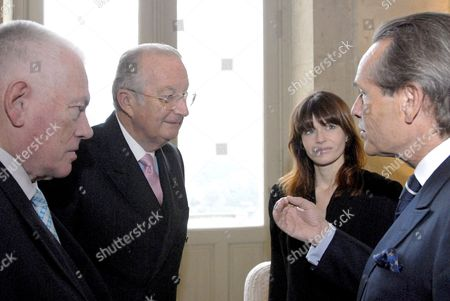 (l-r) Former Anderlecht Manager Michel Verschueren Belgian King Albert Ii Belgian Singer Axelle Red and Belgian Rally Driver Jacky Ickx Chat During a Reception at the Royal Castle For People who Received a Nobility Title in 2007 in Laeken-laken Brussels Belgium 20 December 2007 Belgium Brussels