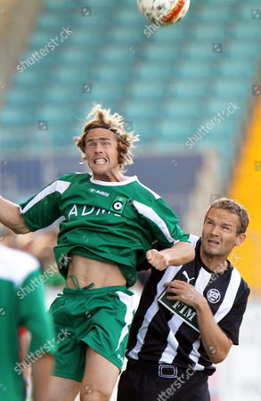 Cercle's Hans Cornelis (l) and Tps Turku's Jonatan Johansson Fight For the Ball During the Second Qualification Game of the Europa League Between Cercle Brugge and Tps Turku of Finland in the Jules Ottenstadion in Gentbrugge Belgium on 15 July 2010 Belgium Gentbrugge