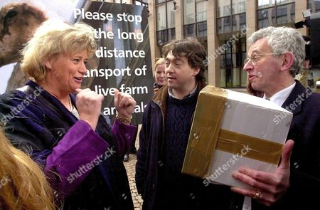 Brussels Belgium : Swedish Minister For Agriculture and President of the European Agriculture Council Margareta Winberg (l) Gestures As She Receives a Box Full of Petitions From the Chairman of Gaia (action Group in the Interest of Animals) Michel Vandenbosch (c) and Peter Stevenson (r) Representative of the Ciwf (compassion in World Farming) on Monday 19 March 2001 in Brussels Prior to the Begininng of the Agriculture Councils Session These Associations Protest Against the Long Distance Transport of Live Farm Animals