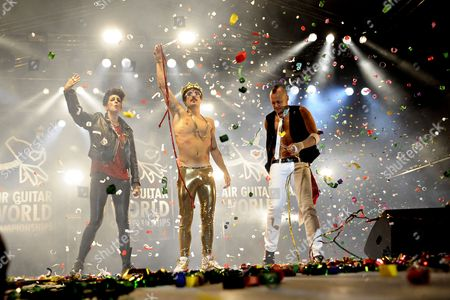 (l-r) Second Placed Soraya Garlenq 'Eva Gina Runner' of France Winner Sylvain Guimene 'Gunther Love' of France and Third Placed Cole Manson 'Johnny Utah' of Canada Acknowledge Applause at the End of the 15th Grand Final of the Air Guitar World Championships (agwc) in Oulu Finland 27 August 2010 Twenty-three Air Guitarists From 19 Countries Took Part in the Competition Finland Oulu