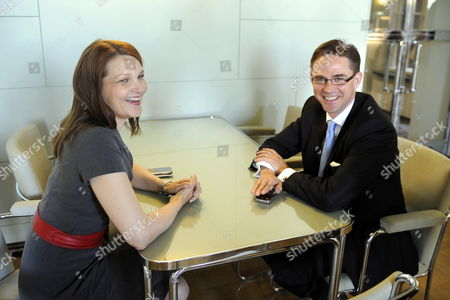 Finland's National Coalition Party Chairman and New Prime Minister Jyrki Katainen (r) Chats with Outgoing Prime Minister Mari Kiviniemi (l) 22 June 2011 After a Plenary Session of the Finnish Parliament Helsinki Finland Katainen Received 118 Votes with 72 Against in a Vote at the Parliament More Than Two Months After National Elections the Vote Formally Puts Katainen 39 in Charge of the Incoming Six-party Coalition That Emerged After the April Elections Katainen Has Until Now Been Finance Minister in a Coalition with the Centre Party Which is Now in Opposition Finland Helsinki