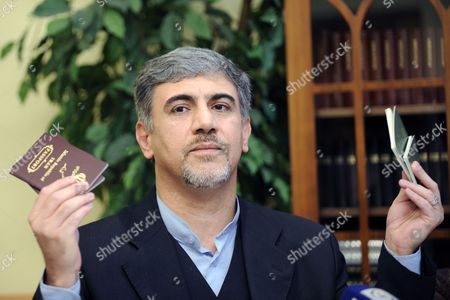 Stock Photo of Iranian Diplomat Hossein Alizadeh Shows Passports During a Press Conference in Helsinki Finland 13 September 2010 the Iranian Diplomat who Has Quit His Job at His Country's Embassy in Finland Says He Will Apply For Political Asylum in Finland Hossein Alizadeh Told Reporters He Left His Job Because He Could not Accept the 'Fraud' Presidential Election in 2009 Finland Helsinki