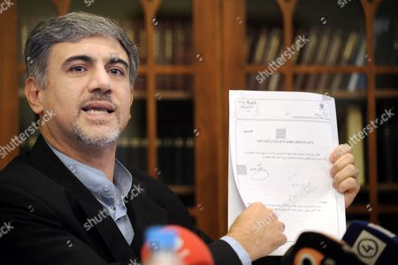 Iranian Diplomat Hossein Alizadeh Shows a Document During a Press Conference in Helsinki Finland 13 September 2010 the Iranian Diplomat who Has Quit His Job at His Country's Embassy in Finland Says He Will Apply For Political Asylum in Finland Hossein Alizadeh Told Reporters He Left His Job Because He Could not Accept the 'Fraud' Presidential Election in 2009 Finland Helsinki
