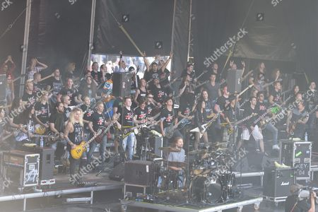Heavy Metal Guitarist Alexi Laiho From the Group Children of Bodom Leads 100 Electric Guitarists Performing on the Big Stage in the Senate Square in Helsinki Finland 14 August 2015 Laiho Has Selected 100 Guitarrists to Play with Him in the Helsinki Main Square Finland Helsinki