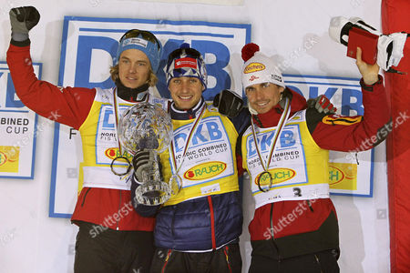 Jason Lamy Chappuis (c) of France Poses with His Trophy on the Podium After Winning the Fis Nordic Combined World Cup Overall Competition in Lahti Finland 12 March 2011 Jason Lamy Chappuis Won Ahead of Second Placed Mikko Kokslien (l) of Norway and Third Placed Felix Gottwald (r) of Austria Finland Lahti