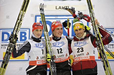 Johannes Rydzek (c) of Germany Smiles on the Podium After Winning the Nordic Combined World Cup in Lahti Finland 12 March 2011 Rydzek Won Ahead of His Second Placed Compatriot Eric Frenzel (r) and Third Placed Felix Gottwald (c) of Austria Finland Lahti