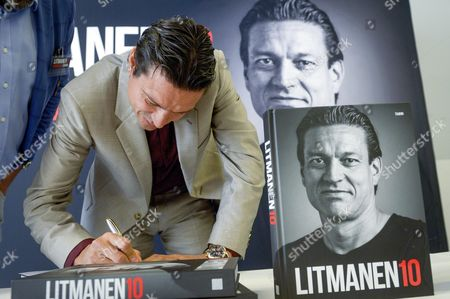 Finnish Former Soccer Player Jari Litmanen Signs a Copy of His Autobiography 'Litmanen 10' During a Press Conference in Helsinki Finland 10 September 2015 Finland Helsinki